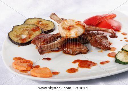 Bone lamb platter with vegetables. Teppan-yaki dish poster