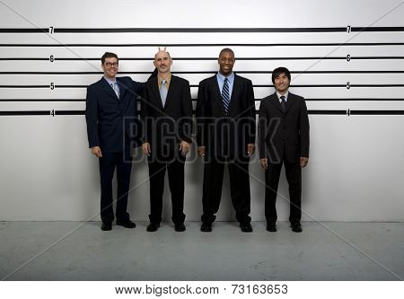 Multi-ethnic businessmen being silly in police line up