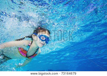 Underwater shot of Asian girl swimming