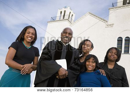 African American Reverend and family