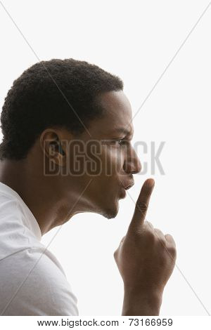 Profile of African American man shushing