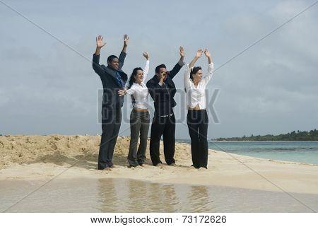 Multi-ethnic businesspeople waving at beach