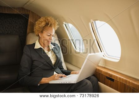 African American businesswoman on airplane