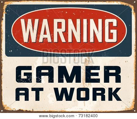 Vintage Metal Sign - Warning Gamer At Work - Vector EPS10. Grunge effects can be easily removed for a cleaner look.
