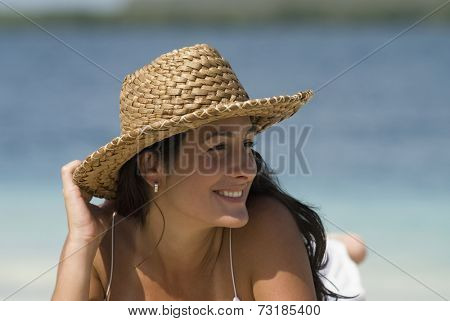 Hispanic woman wearing straw hat