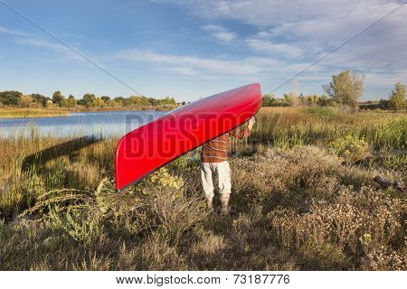 portaging canoe between lakes, Riverbend Ponds Natural Area, Fort Collins, Colorado