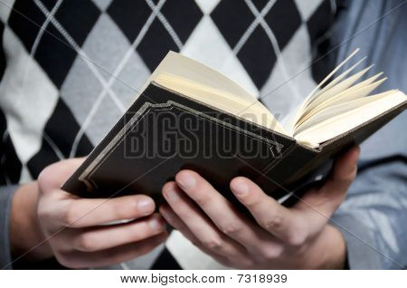HANDS AND BIBLE