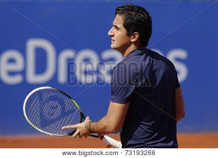 BARCELONA - APRIL, 23: Spanish tennis player Nicolas Almagro in action during a match of Barcelona tennis tournament Conde de Godo on April 23, 2014 in Barcelona