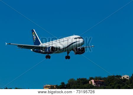 CORFU, GREECE - SEPTEMBER 29: A airways aircraft on approach on SEPTEMBER 29, 2014 in Corfu, Greece. airways is a national Greek airline