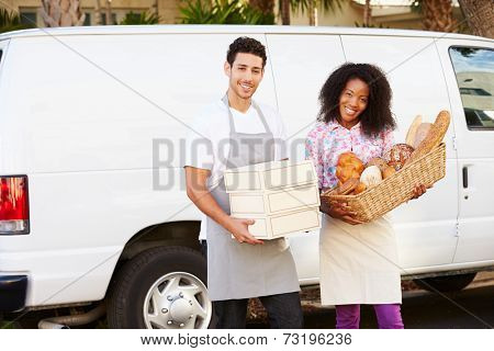 Bakers Unloading Bread And Cakes From Van