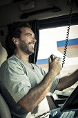 Portrait of a truck driver using CB radio poster
