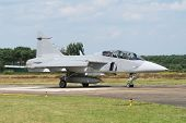 Gripen taxiing off the runway of a European airbase poster