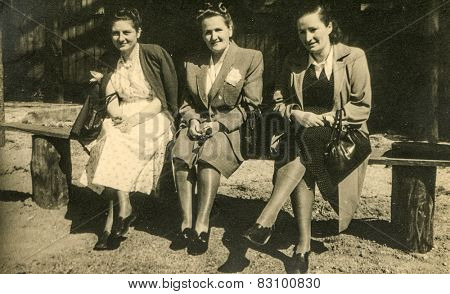 BERLIN, GERMANY, CIRCA 1930's: Vintage photo of three women sitting on bench