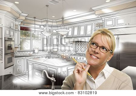 Creative Woman With Pencil Over Custom Kitchen Design Drawing and Photo Combination on White.