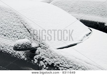 Snow covered car windshield