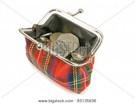 An open purse full of British money