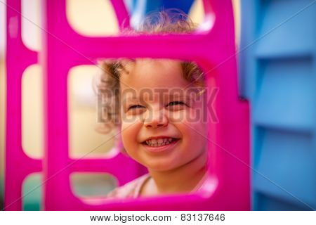 Little Girl Playing At Home