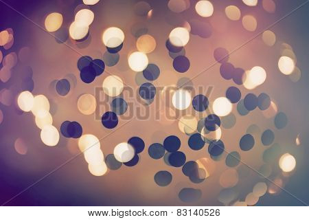 Abstract bokeh glittering light effects background