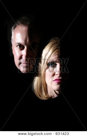 Husband and wife being exposed by coming into the light. poster