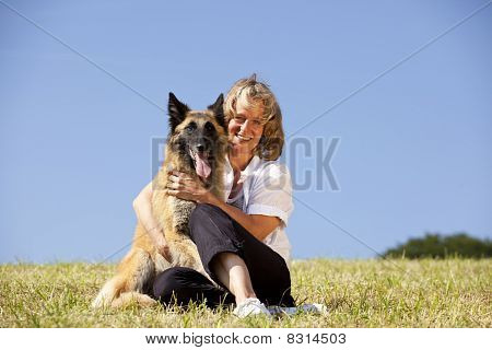 smiling woman with her dog