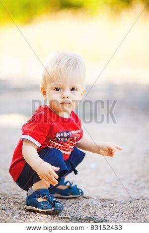 little boy portrait in the park