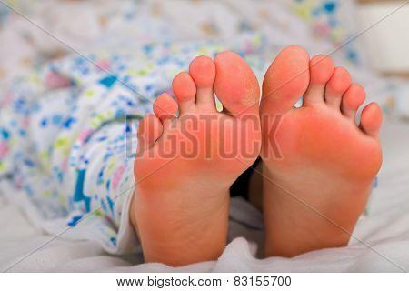 Legs In Bed