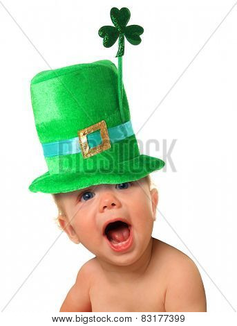 Funny St Patricks day baby wearing a green hat with a shamrock.