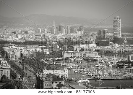 Barcelona cityscape. View seen from Montjuic. Port Vell marina and other buildings. Black and white tone. poster