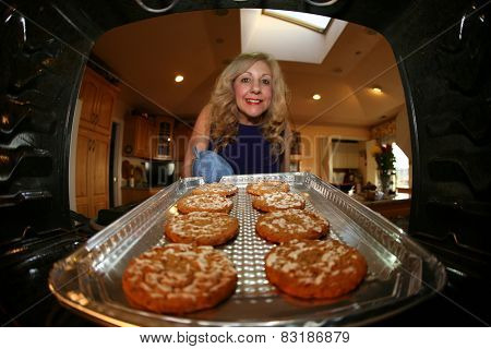 A sweet lady bakes up a batch of GLUTEN FREE Cookies. research showed between 0.5 and 1.0 percent of people in the US and UK are sensitive to gluten due to Celiac Disease. Gluten Free