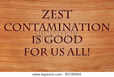 Zest contamination is good for us all - an inspirational quote with concept that zest for life can improve everyone's life - on wooden background