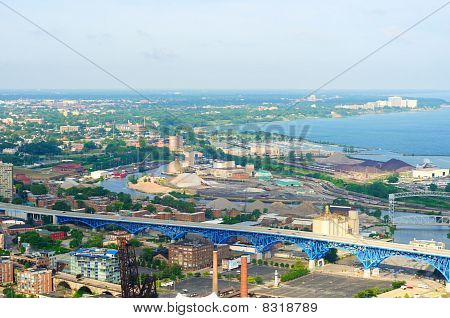 Aerial view of Cleveland Ohio looking west over the industrial Flats and Lake Erie shoreline poster