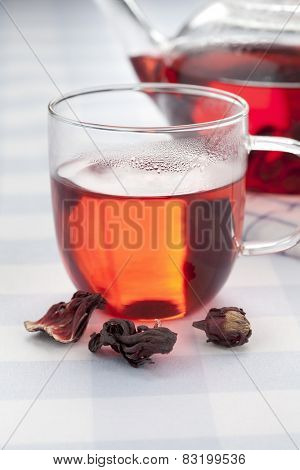 Cup of hot hibiscus tea and sepals
