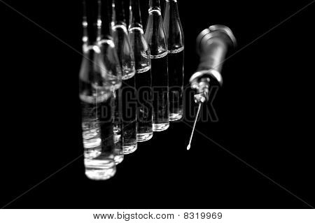 syringe and medicaments on a black backgroun