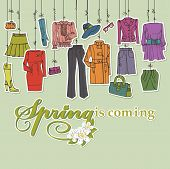 Colored Fashionable female clothing and accessories set on Sketchy style.Clothing hanging on ropes.Woman wear sticker or label. Headline spring is comming.Square composition,background.Fashion Vector poster