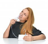 Young woman using nebulizer for respiratory inhaler Asthma Treatment isolated on a white background poster