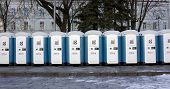 "VILNIUS LITHUANIA - NOVEMBER 29 2014: Bio toilets on a main square. The city is ready to celebrate Christmas. ""Toi Toi"" brand leases streets bio toilets in 33 countries of the world. poster"