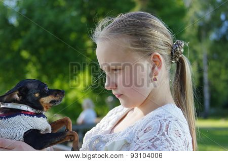 Portrait of a young girl with dog