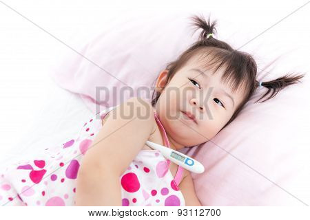 Little Girl Lying On Sickbed With Digital Thermometer In Her Armpit