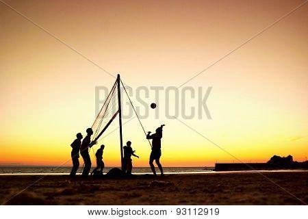 Beach volleyball at sunset