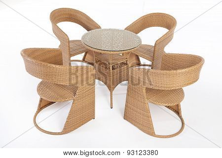Suite of wicker furniture made of synthetic fibre on isolated background poster