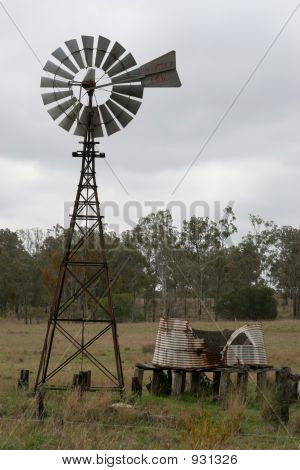 Old Windmill And Tank