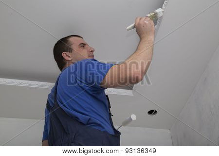 Renovation of house interior. Man worker painting.