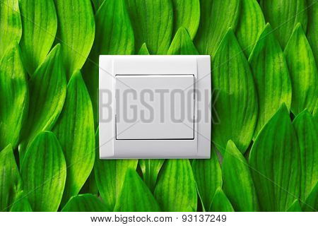 Light switch on green leaves background poster
