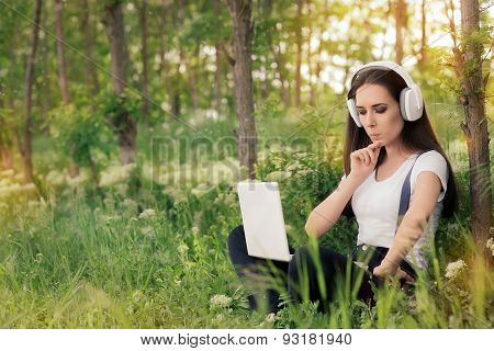 Curious  Girl with Headphones and Laptop