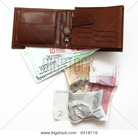 Old crumpled Estonian money and new euro money in the wallet, closeup poster