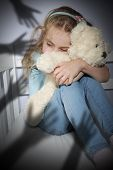 Bullying frightened child hugging a teddy bear poster