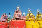 Colorful buoys for navigation in the sea poster