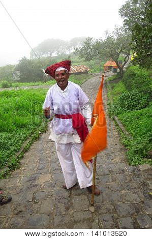 Pune, India - July 20, 2015: An elderly person dressed as an ancient hindu warrior called as the Mawla on Sinhagad fort.