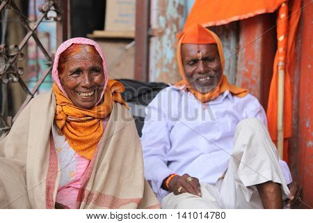 Pune, India - July 11, 2015: A portrait of an old pilgrim woman smiling happily during an Indian pilgrimmage.