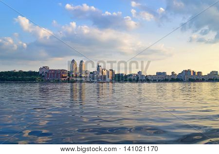 Panoramic view of Dnipropetrovsk city from Dnieper river. Early evening view of Dnipro city. Dnepropetrovsk city skyline.